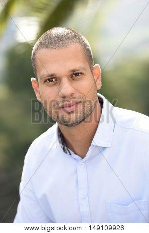portrait of hispanic guy standing outside