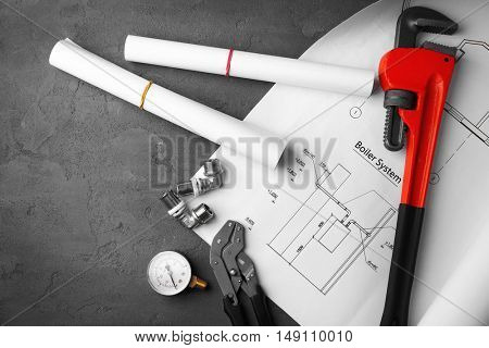 Plumbing tools with house plan on concrete structure background