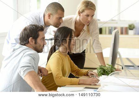 business team working together on desktop