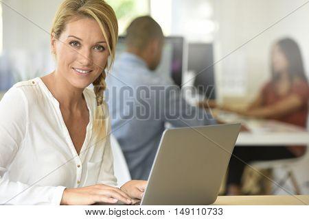 Blond businesswoman working in office