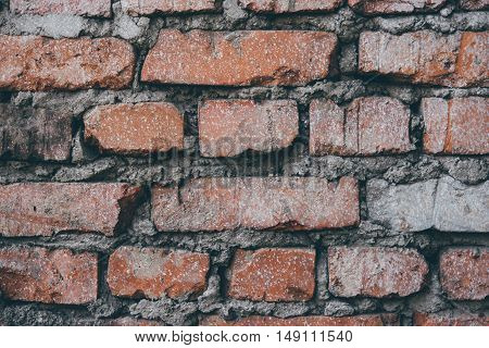 Texture of bricks on the wall of building
