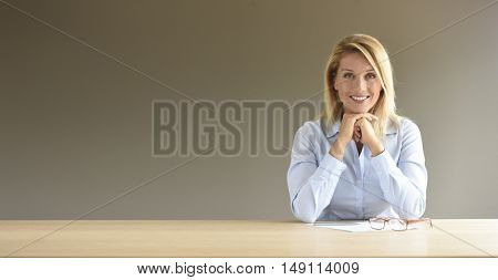 Portrait of middle-aged businesswoman, isolated