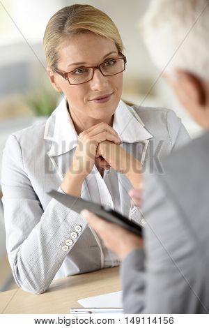 Businesswoman with client in business meeting