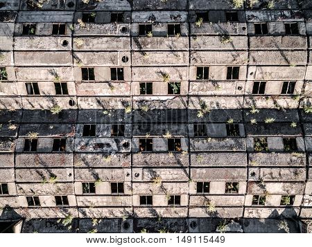 large obsolete building roof with windows, earial photo, top view