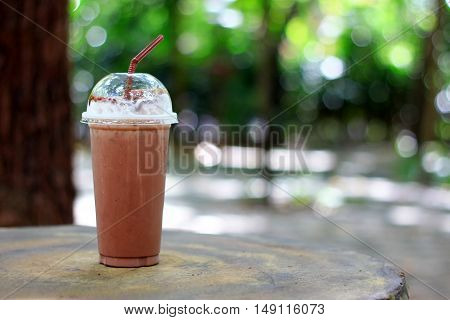 ice chocolate on wood table and green background