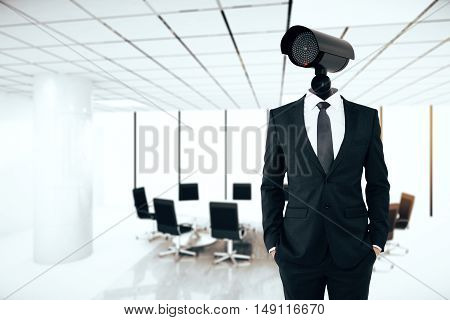 Business security management concept. Businessman with CCTV camera instead of head on conference room background