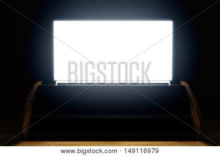 Illuminated Tv Screen In Dark Room