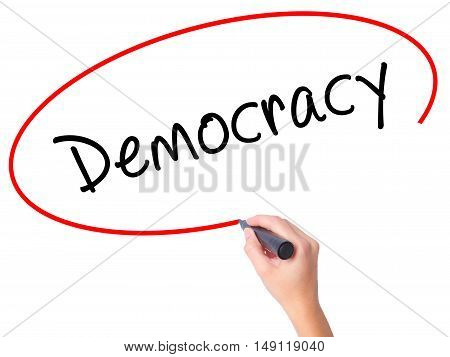 Women Hand Writing Democracy With Black Marker On Visual Screen