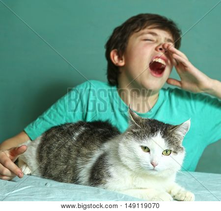 preteen boy with allergy on cat fur sniff close up photo
