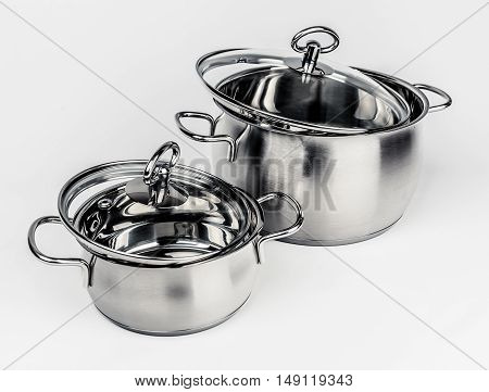 Two Metal stock pots with glass lid. Cookware