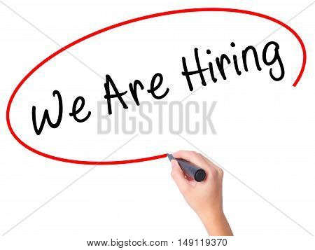 Women Hand Writing We Are Hiring  With Black Marker On Visual Screen