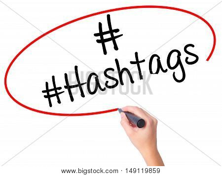 Women Hand Writing #hashtags  With Black Marker On Visual Screen