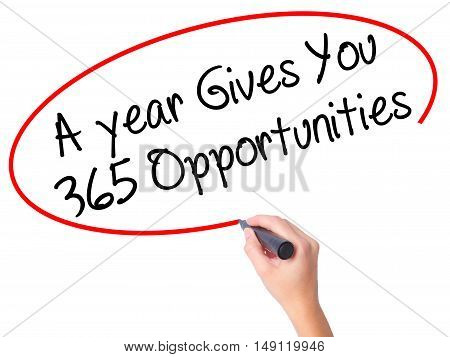 Women Hand Writing A Year Gives You 365 Opportunities With Black Marker On Visual Screen