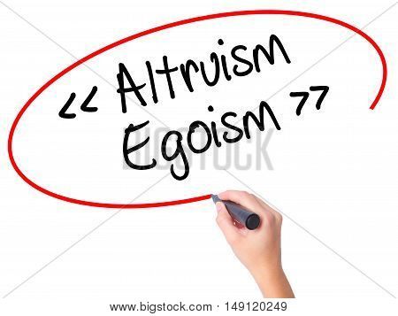 Women Hand Writing Altruism - Egoism With Black Marker On Visual Screen.
