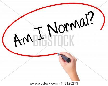 Women Hand Writing Am I Normal? With Black Marker On Visual Screen