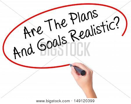 Women Hand Writing Are The Plans And Goals Realistic? With Black Marker On Visual Screen.