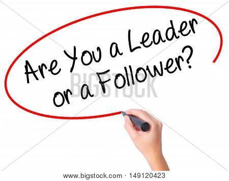 Women Hand Writing Are You A Leader Or A Follower? With Black Marker On Visual Screen