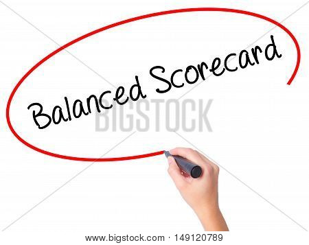 Women Hand Writing Balanced Scorecard With Black Marker On Visual Screen
