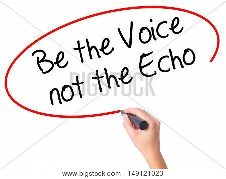 Women Hand Writing Be The Voice Not The Echo With Black Marker On Visual Screen.