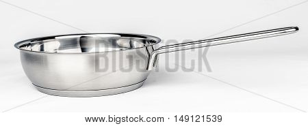 Metal fry pot on white background. Cookware