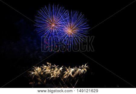 colorful fireworks in night sky. fireworks festival. Fireworks display on dark sky background