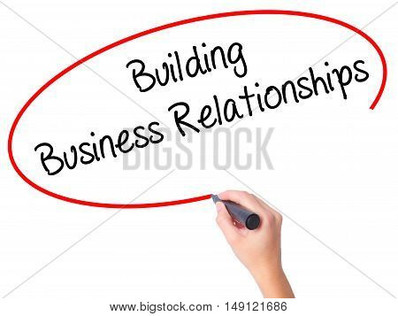 Women Hand Writing  Building Business Relationships  With Black Marker On Visual Screen