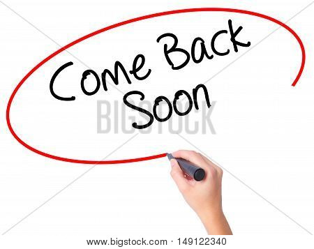 Women Hand Writing Come Back Soon With Black Marker On Visual Screen.
