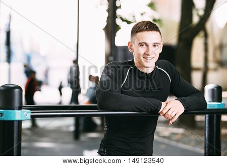 Outdoor portrait of healthy handsome active man with fit muscular body, sports and fitness concept.