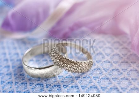 Two wedding rings on white lace