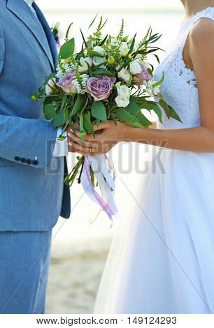 Happy wedding couple on river background