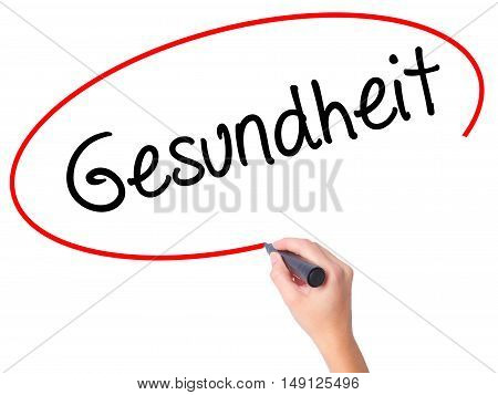 Women Hand Writing Gesundheit (health In German)  With Black Marker On Visual Screen.