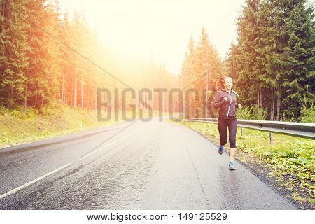 Fitness Woman Running At The Morning In Mountains.
