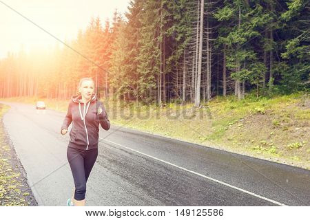 Smiling Slim Woman Jogging At The Rainy Morning