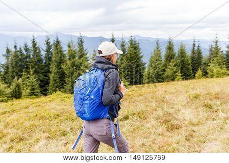 Young Backpacker Woman Enjoying Mountain Trip