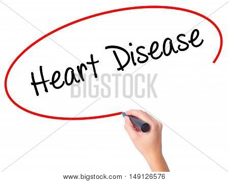 Women Hand Writing Heart Disease With Black Marker On Visual Screen