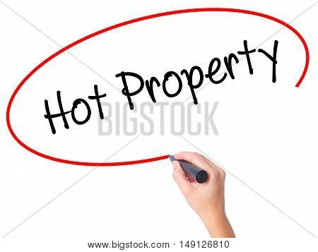 Women Hand Writing Hot Property With Black Marker On Visual Screen