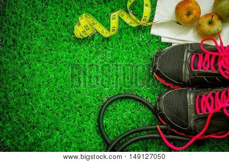 Sports Shoes On The Background Of Green Grass