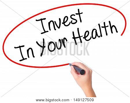 Women Hand Writing Invest In Your Health With Black Marker On Visual Screen.