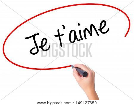 Women Hand Writing Je T'aime ( I Love You In French)  With Black Marker On Visual Screen