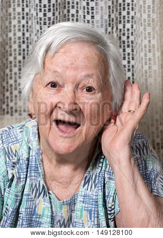 Old Woman Putting Hand To Her Ear