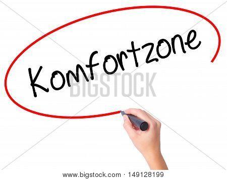 Women Hand Writing Komfortzone  (comfort Zone In German)  With Black Marker On Visual Screen