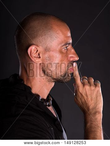 Young Bald Handsome Man Showing Silence Gesture