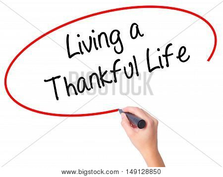 Women Hand Writing Living A Thankful Life With Black Marker On Visual Screen