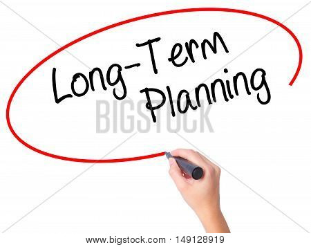 Women Hand Writing  Long-term Planning With Black Marker On Visual Screen