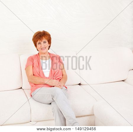 Woman on sofa at home. Adult female
