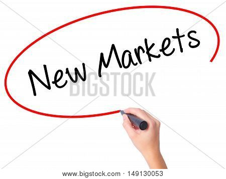 Women Hand Writing New Markets With Black Marker On Visual Screen