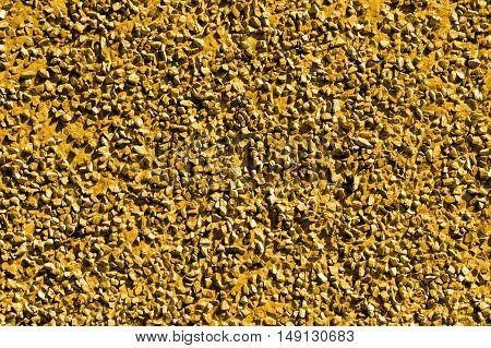 Golden stones, gravel texture, macro background photo