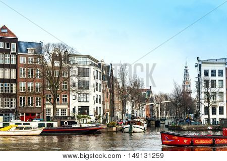 Amsterdam, Netherlands - March 31, 2016 : Beautiful street view of Traditional old buildings in Amsterdam, the Netherlands