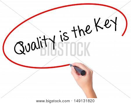 Women Hand Writing Quality Is The Key With Black Marker On Visual Screen