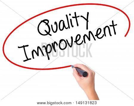 Women Hand Writing Quality Improvement With Black Marker On Visual Screen.